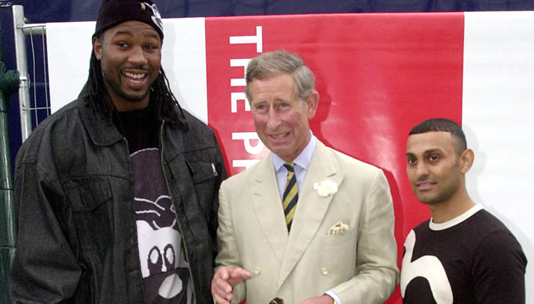 The Prince of Wales with World Heavyweight boxing champion Lennox Lewis (left) and Sheffield featherweight boxer Prince Naseem Hamed during the Capital Radio Party in the Park at Hyde Park in London.